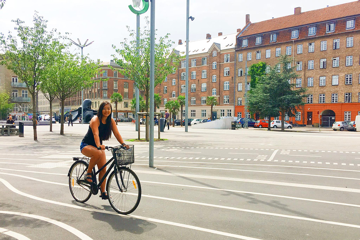 Katie-Li Walker '18, a double major in architectural studies and studio art, bikes through Superkilen, a public park in the Nørrebro district of Copenhagen, Denmark during her time abroad.