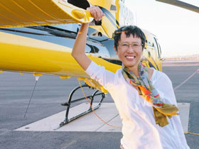 Xu Xi in front of a helicopter