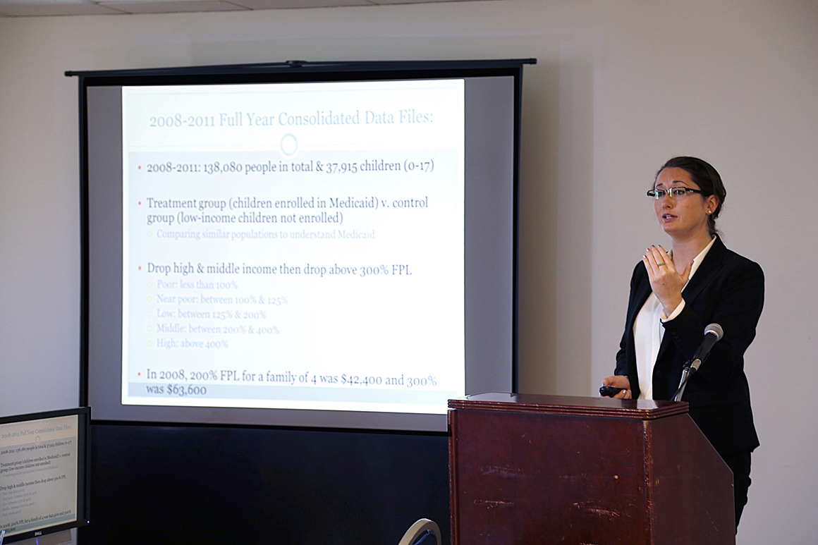 Jeanne Kiernan '14, an economics major in the health professions and College Honors programs, presents during the 2014 Academic Conference.