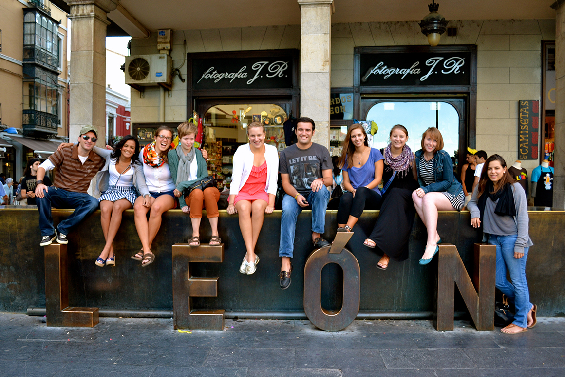 students in front of a LEON sign