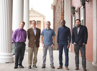 From left, Kevin Walsh, Aaron Seider, Justin McAlister, Andre Isaacs '05, Daina Harvey stand on Fenwick porch. Not pictured: K.J. Rawson.