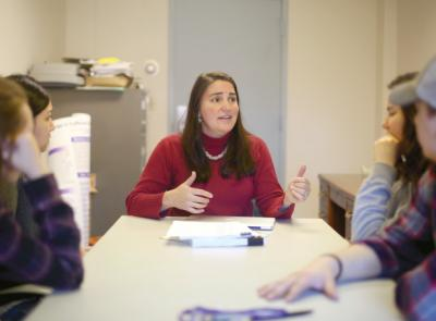 Alison Bryant Ludden, associate professor of psychology, speaks with students about her research