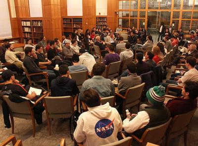 Students, faculty and staff discuss the topic of guns in a moderated fishbowl.
