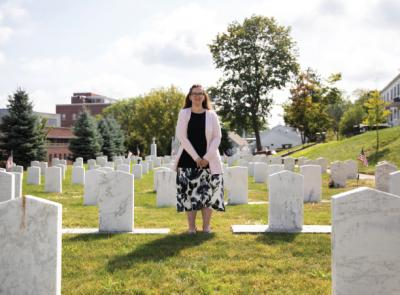 Sarah Campbell stands in the Jesuit Cemetery on campus