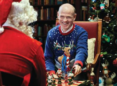 Bill Abbott '84 plays chess with Santa Claus