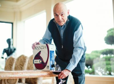 Art Ciocca '59 pours a glass from the iconic, innovative box of Franzia Merlot