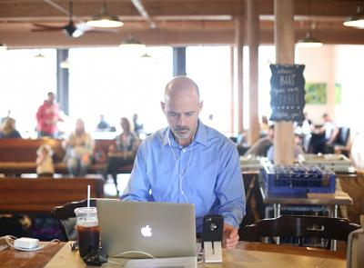 "Ed O'Donnell, associate professor of history at Holy Cross, is seen here working on his podcast ""In The Past Lane"" at BirchTree Bread Company in Worcester. Photo by Tom Rettig"