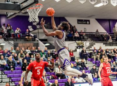 men's basketball player jehyve floyd goes to dunk a basketball