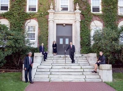 The Sanctae Crucis honorees stand on the front steps of ivy-covered Wheeler Hall