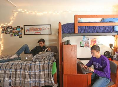two students study in their room