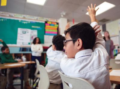 A Nativity School of Worcester student raises his hand in class
