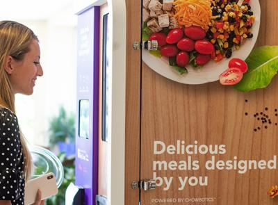 Image of student using Sally the Food Robot. Photo courtesy of Holy Cross Dining