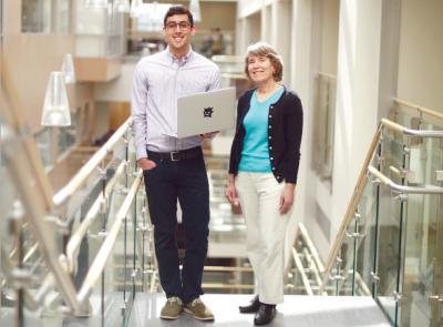 Lucca Eloy '18 stands next to mathematics and computer science Professor Constance Royden, with whom he works closely to develop an independent project to artificially model the way the brain processes visual information.