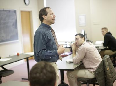 Victor Matheson, professor of economics, is seen here teaching a class at Holy Cross. Photo by Tom Rettig