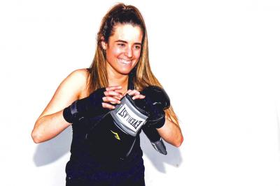 Mary Kate Vanecko '17 posts with boxing gloves in her senior year at Holy Cross