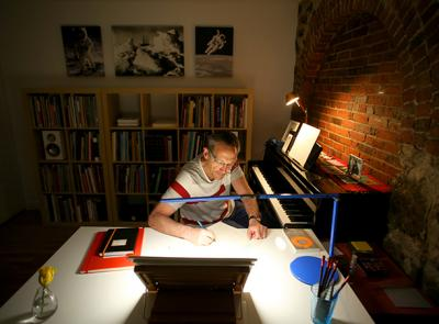 Osvaldo Golijov is pictured here working in his music studio. Photo by Tom Rettig