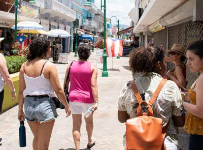 Students and professors walk down a street in Puerto Rico