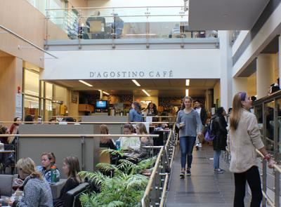 Students walk through D'Agostino Caf? in the Integrated Science Complex.