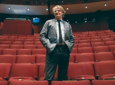 "Bartlett Sher '81 stands in the house of the Lincoln Center Theater before a June performance of ""My Fair Lady"""