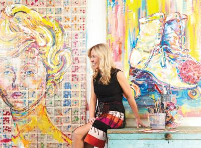 Maggie O'Neill '99 beside her colorful work