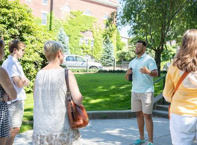 A student leads a tour of campus