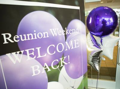 Sign reads: Reunion Weekend Welcome Back!