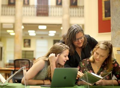 Professor of history Stephanie Yule works with two students during summer research last year.