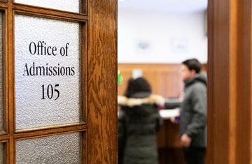 door that says office of admissions with people inside