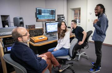 Faculty interacting with students in Brooks Recording Studio