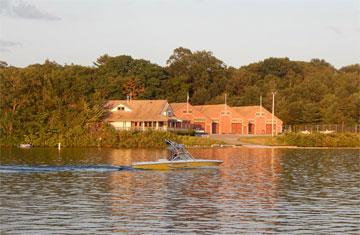 donahue rowing center with water boat in center of lake