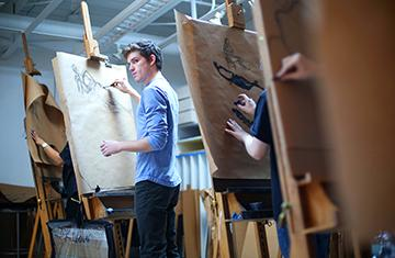student working at an easel