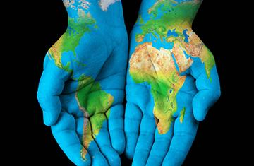 Hands with blue outline of Earth