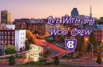 Worcester skyline at rush hour with the words Live with the Woo Crew and Holy Cross logo on top of image