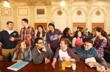 students posing for a photo in kimball dining hall