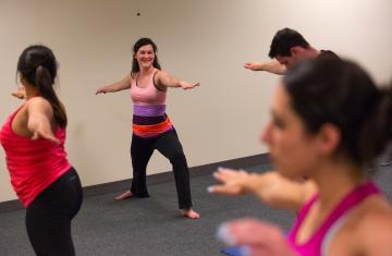four students performing yoga