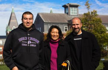 student with his parents at Family Weekend on campus