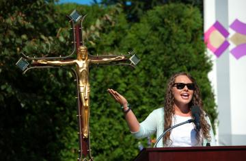 student at podium during Mass of the Holy Spirit