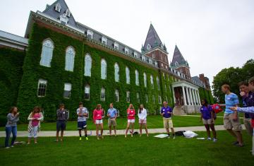 students taking part in group exercise during summer orientation