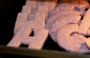sugar cookies in the shape of H and C