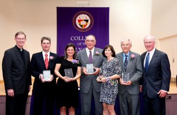 Sanctae Crucis award recipients holding their award flanked by Fr. Boroughs and John Mahoney '73, chair of board of trustees