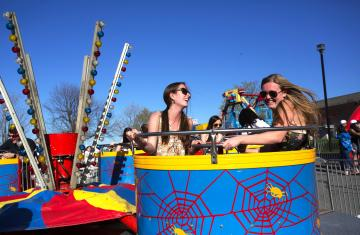 students taking a ride on an amusement park ride as part of Spring Weekend
