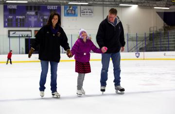 family members ice skating as part of Winter Homecoming activities