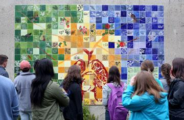 students view artwork outside of dinand library