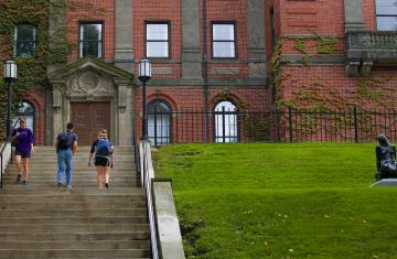 students walk up the stairs to the library