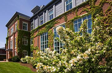 smith hall with a flowering bush
