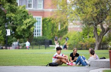 group of students lounging on hogan courtyard