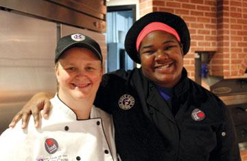 two holy cross dining employees posing for camera