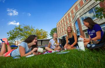 students lounging on the Hogan Courtyard