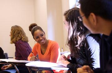 students sitting and smiling in a classroom