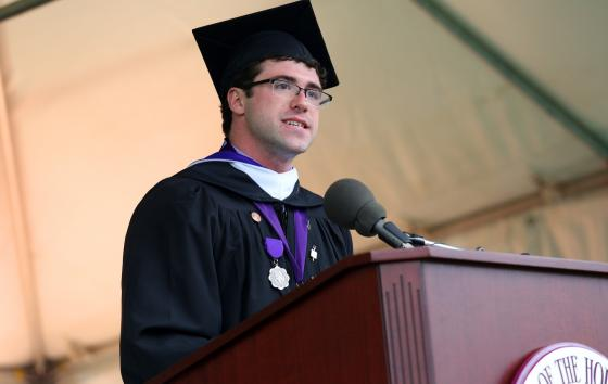 male valedictorian speaking at commencement